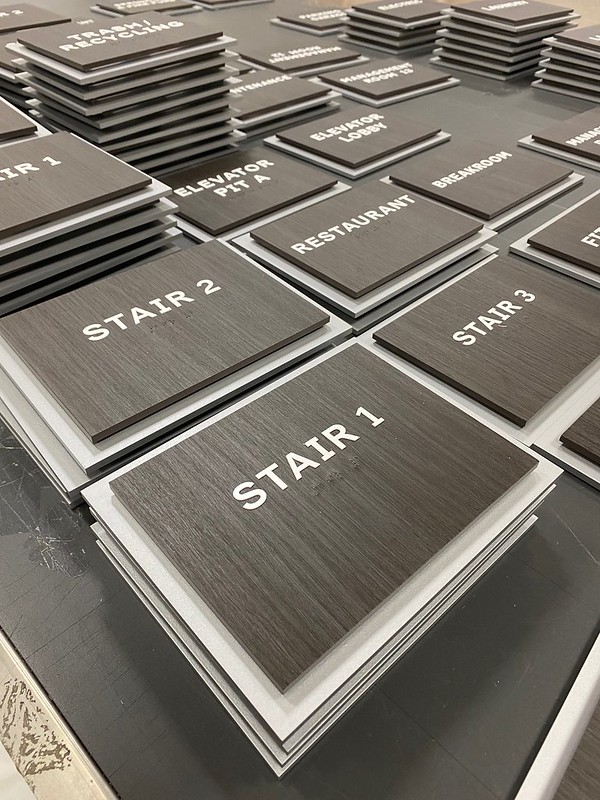 Tactile Building signage showing multiple directional signage plates.