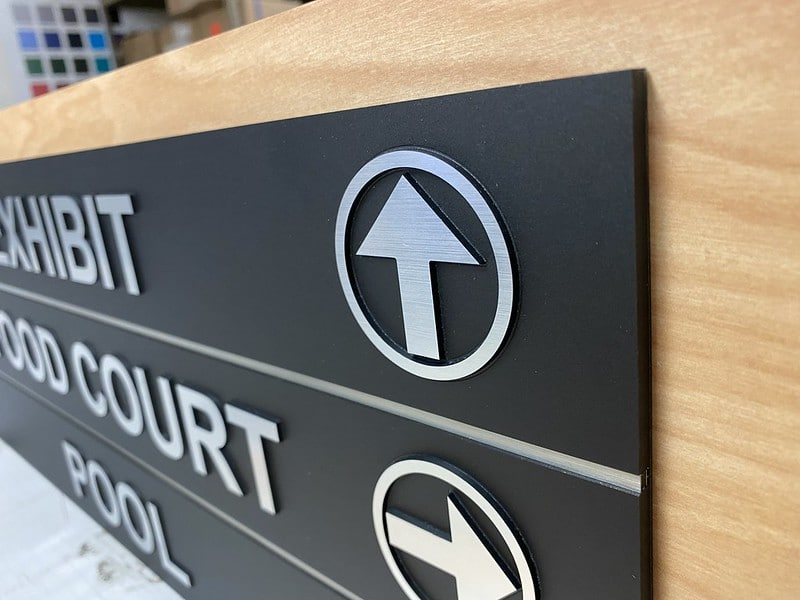 Directional Signage with raised fonts and arrows